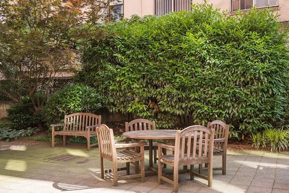 a wooden bench in a garden
