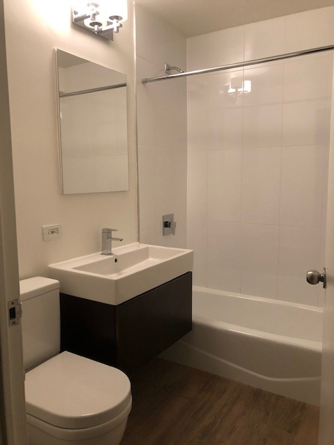 Atlas New York: 16J a shower that has a sink and a mirror
