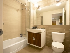 Thumbnail of Gotham West: 2107 a white sink sitting under a mirror
