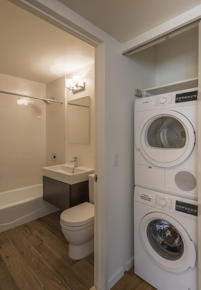 Atlas New York: 21D a white sink sitting under a mirror