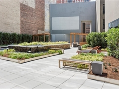 a garden in front of a brick building