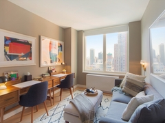 Thumbnail of Gotham West: PH203 a living room filled with furniture and a large window