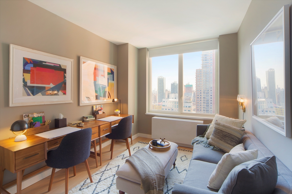 Gotham West: PH203 a living room filled with furniture and a large window