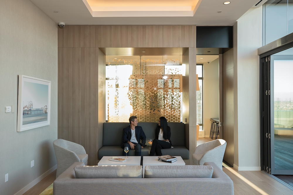 The Ashland: 28M a living room filled with furniture and a large window