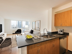 Thumbnail of Atlas New York: 16F a kitchen with a table in a room