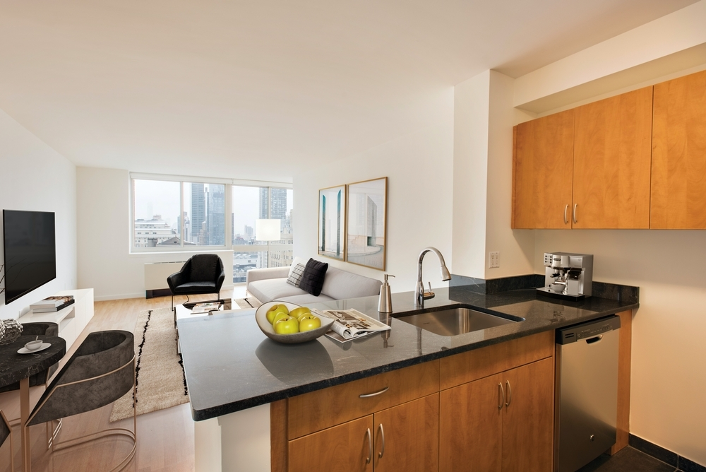 Atlas New York: 16F a kitchen with a table in a room