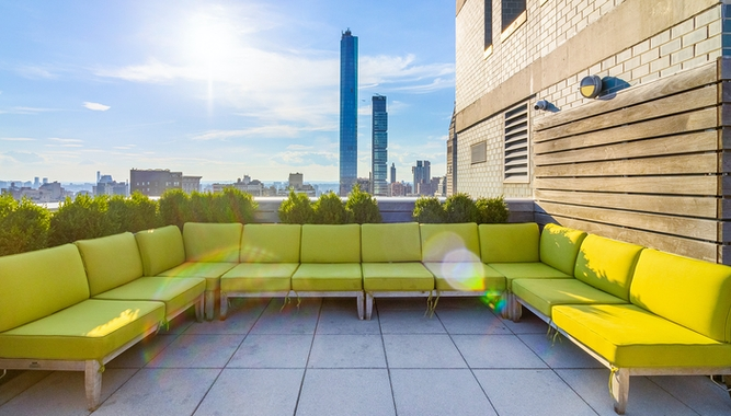 a living room with a couch and table in front of a building