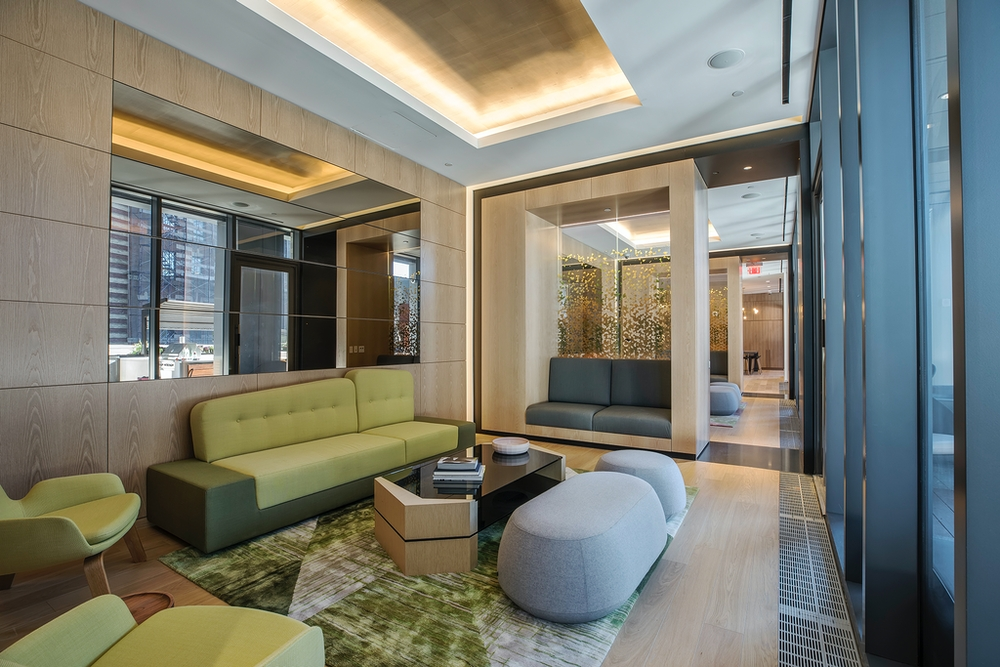 The Ashland: 23C a living room filled with furniture and a large window