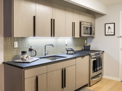 Thumbnail of The Ashland: 24B a modern kitchen with stainless steel appliances and wooden cabinets