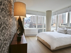 Thumbnail of Gotham West: 3008 a large white bed sitting next to a window