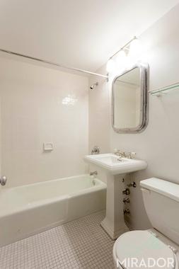 a sink sitting under a mirror