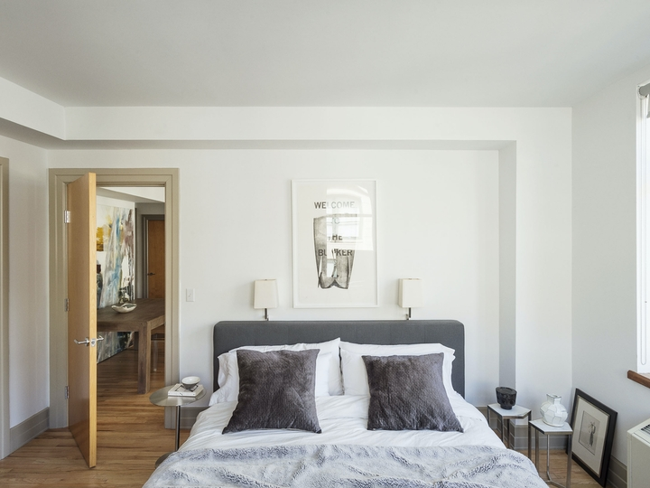 a bedroom with a bed in a room