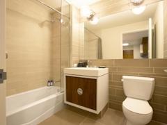 Thumbnail of Gotham West: 2616 a white sink sitting under a mirror