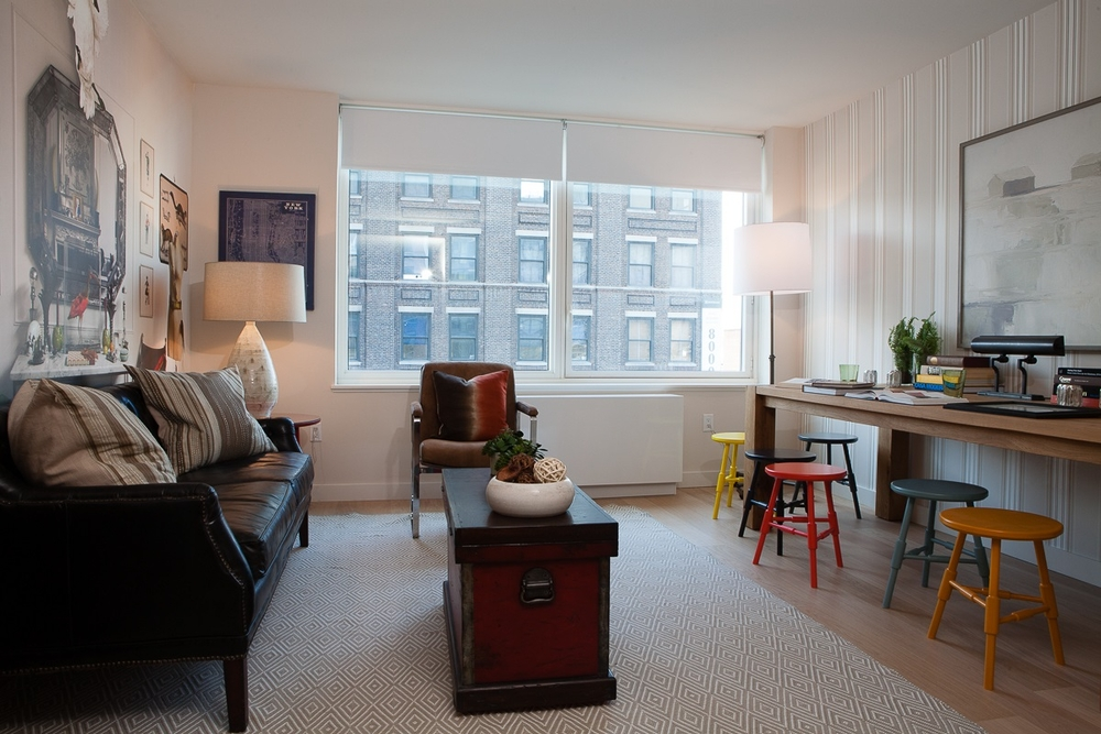 Gotham West: 421 a living room filled with furniture and a large window