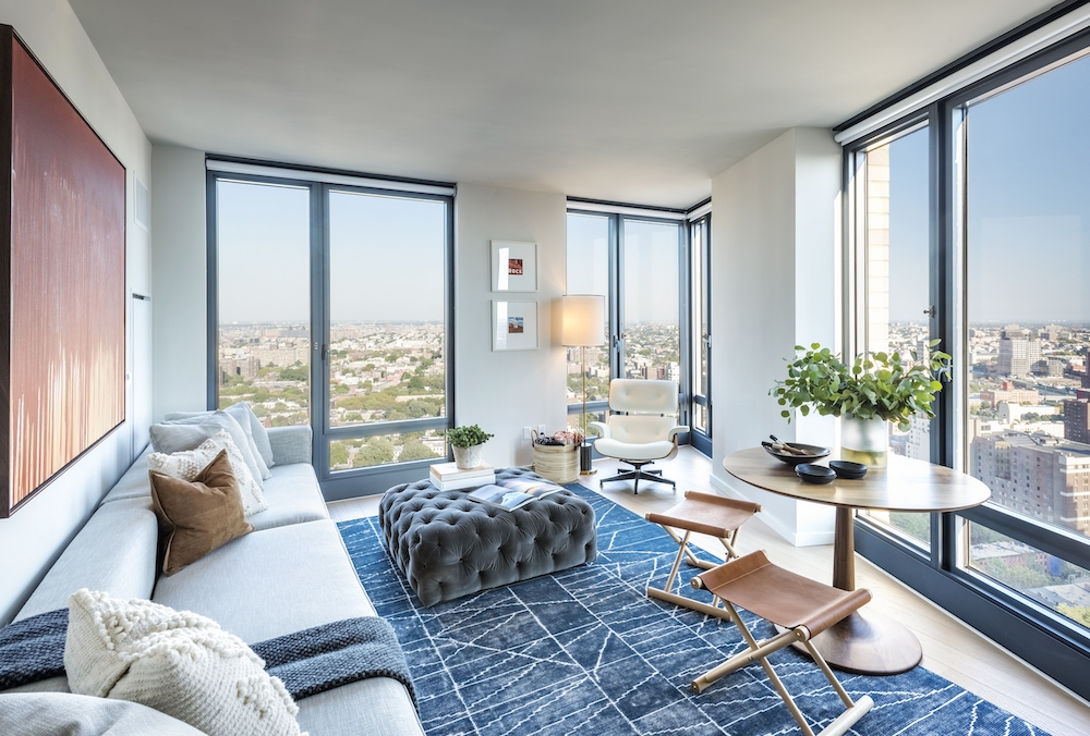 The Ashland: 25K a living room filled with furniture and a large window