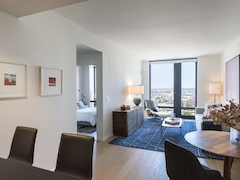 Thumbnail of The Ashland: 23N a living room filled with furniture and a large window