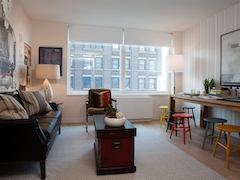 Thumbnail of Gotham West: 415 a living room filled with furniture and a large window