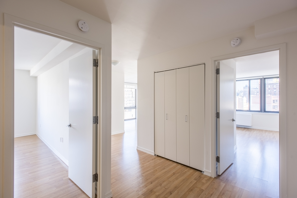 The Nicole: 7E a large empty room with a wood floor