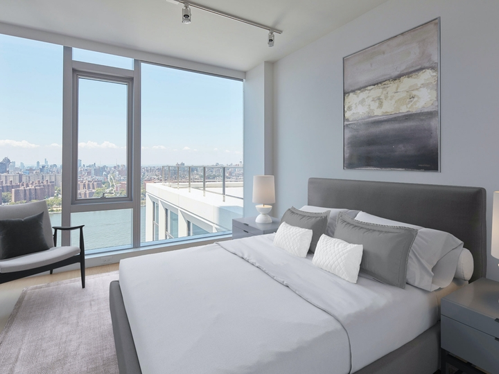 a hotel room with a bed and a large window