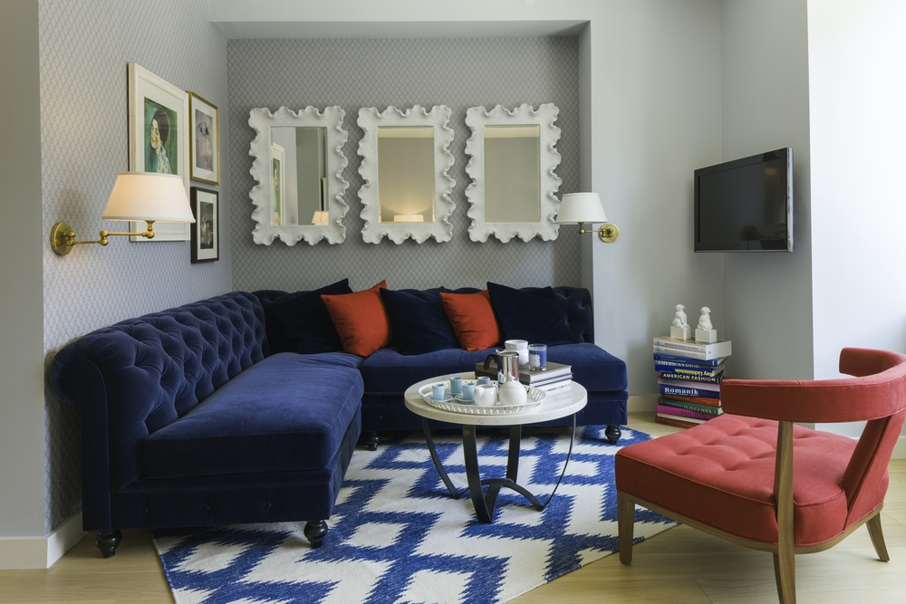 Gotham West: PH110 a living room filled with furniture and a rug