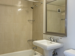 Thumbnail of The Nicole: 18D a large white tub sitting next to a sink
