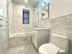 a room with a sink shower and tub