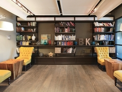 a room filled with furniture and a book shelf