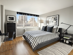 Thumbnail of Atlas New York: 18B a living room filled with furniture and a flat screen tv