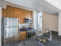 Thumbnail of Atlas New York: 36C a modern kitchen with stainless steel appliances