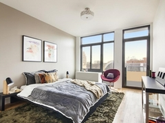 a bedroom with a bed and window in a room