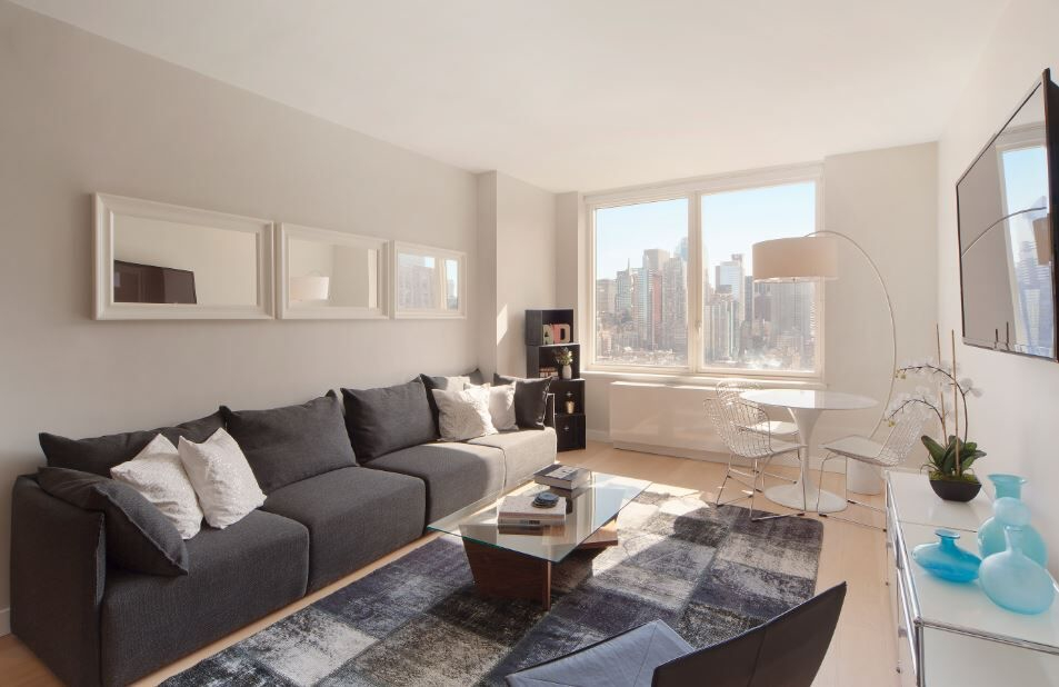 Gotham West: 2106 a living room filled with furniture and a large window