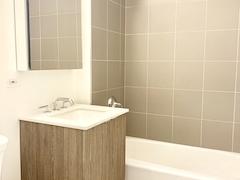 a white tub sitting next to a sink