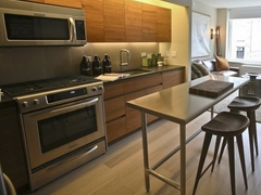 Thumbnail of Gotham West: 918 a stove top oven sitting inside of a kitchen