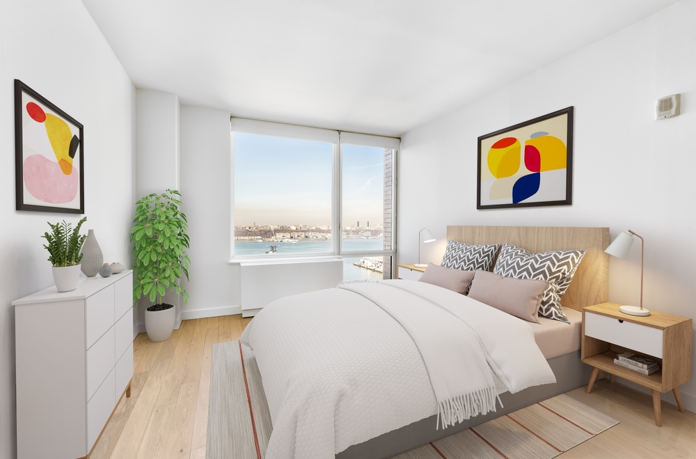 Gotham West: 2508 a bedroom with a large bed in a room