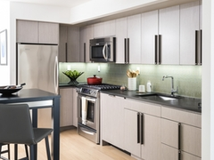 Thumbnail of The Ashland: 42F a kitchen with an island in the middle of a room