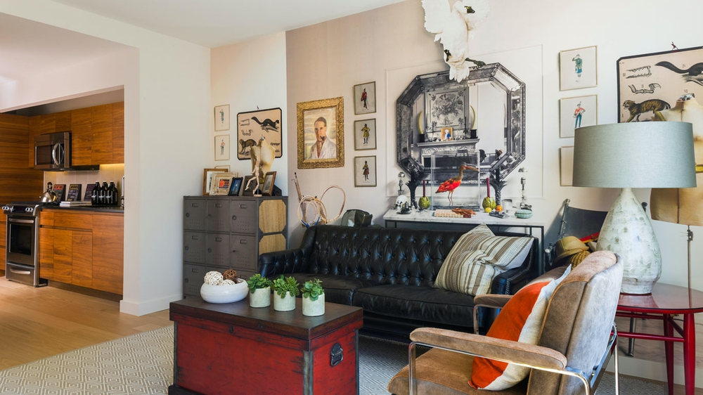 Gotham West: 1005 a living room filled with furniture and a fire place