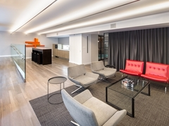 Thumbnail of Atlas New York: 26E a room filled with furniture and a large window
