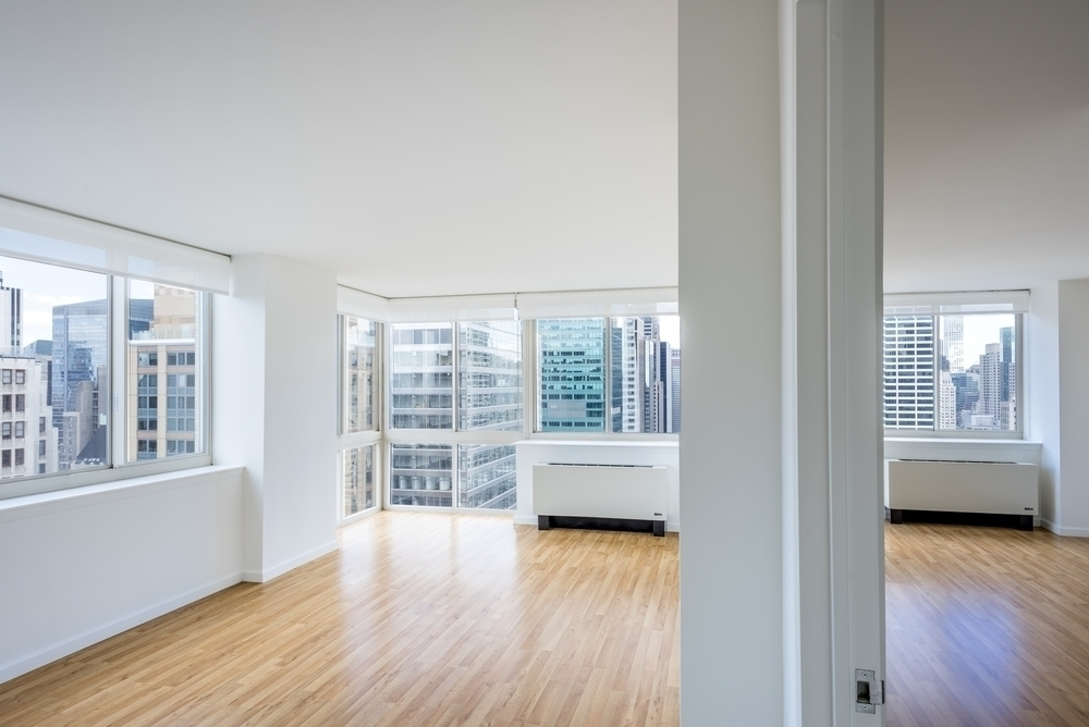 Atlas New York: 45F a room with a large window