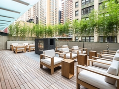 Thumbnail of Atlas New York: 14E a wooden bench sitting in front of a building