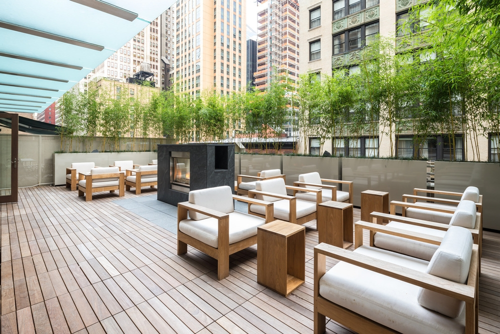Atlas New York: 14E a wooden bench sitting in front of a building
