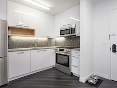 a kitchen with a white refrigerator freezer sitting in a room