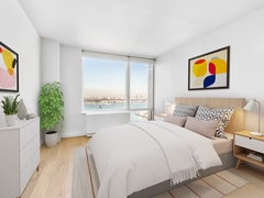 Thumbnail of Gotham West: 1409 a bedroom with a large bed in a room