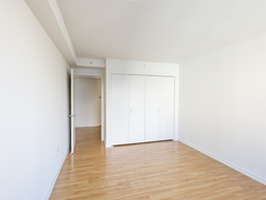 Thumbnail of The Nicole: 19A a room with a wooden floor