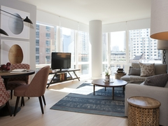 Thumbnail of Gotham West: 1502 a living room filled with furniture and a large window