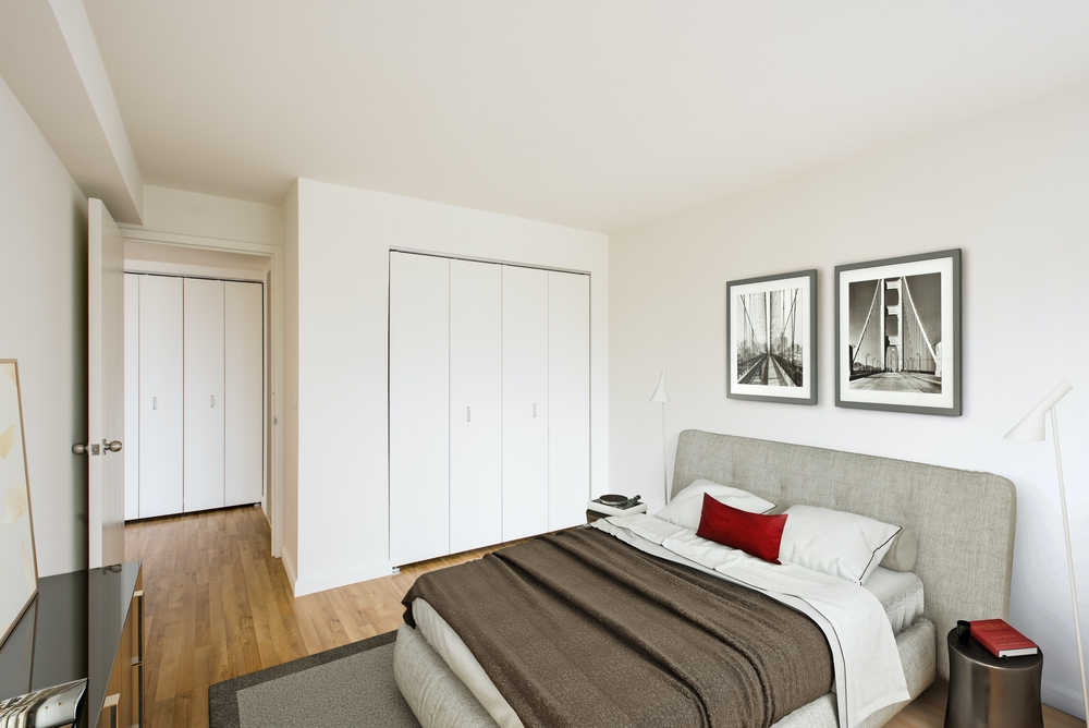 Atlas New York: 6K a bedroom with a bed and desk in a room