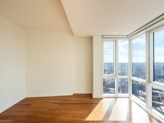 a room with wooden floors and a large window