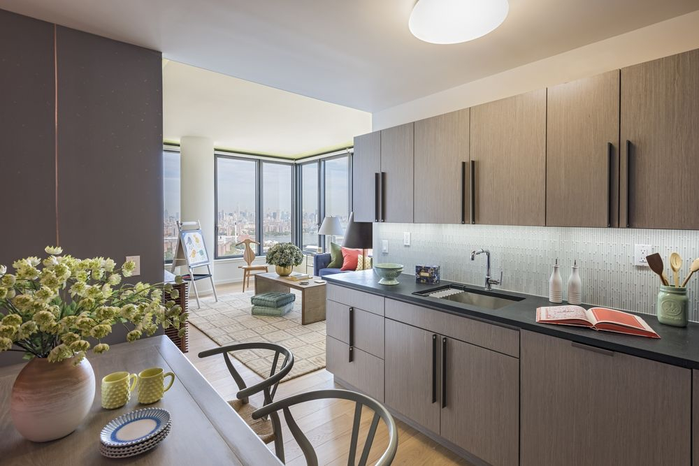 The Ashland: PH1B a kitchen with a sink and a dining table