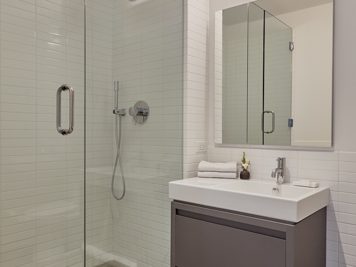 a shower that has a sink and a mirror