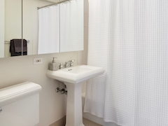 Thumbnail of Atlas New York: 10F a white sink sitting next to a shower