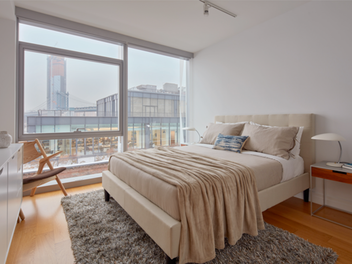 a bedroom with a large bed in a room